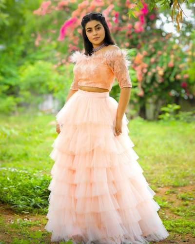 Exquisite Peach Color Function Wear Soft Net Embroidered Work Lehenga Choli